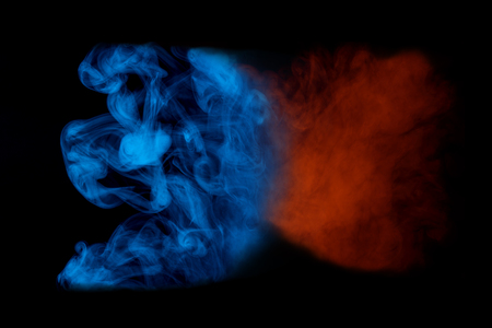 orange blue ghost cloud of cigarette vapor close up colored smoking concept 写真素材
