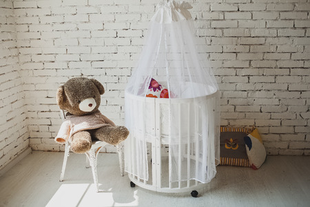 room background: Elegant expensive bed for newborn baby. Luxury decorations of apartments.
