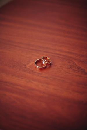 wedding flowers: luxury wedding rings with stylish decoration near them.