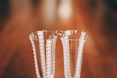 wedding flower: luxury wedding rings with stylish decoration near them.