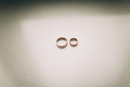 wedding celebration: luxury wedding rings with stylish decoration near them.