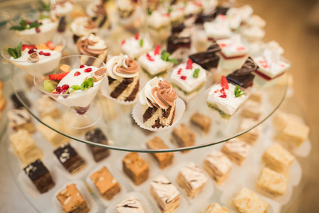 dessert buffet: Different delicious desserts and cakes on the buffet table. Stock Photo