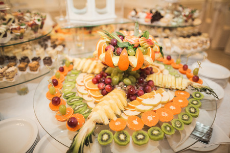 sliced fruit: Various sweet sliced fruit on a buffet table. Stock Photo