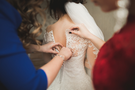 buddies: Happy buddies helps bride getting ready for her wedding day in the morning.