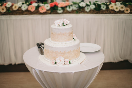 Luxury decorated wedding cake on the table.