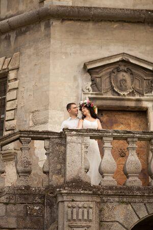 happy wedding: Happy wedding couple hugging on background old castle. Stock Photo