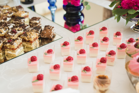 patisserie: Buffet with a variety of delicious sweets, food ideas, celebration. Stock Photo