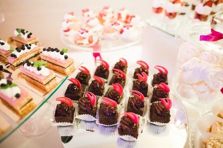 Delicious wedding reception candy bar dessert table. Stock Photo