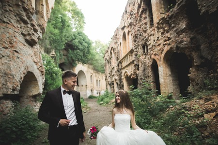 Sensual married couple, valentines hugging in front of old slavic castle.