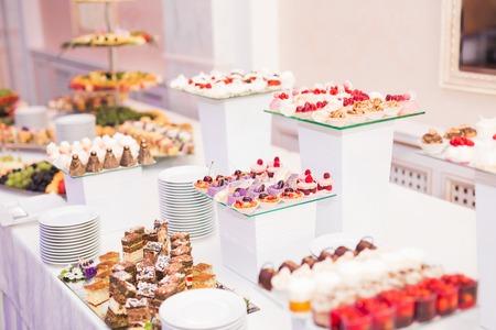 dessert table: Delicious wedding reception candy bar dessert table. Stock Photo