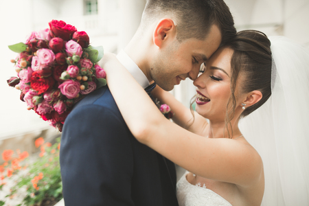 happy wedding: Portrait of happy newly wedding couple with bouquet.