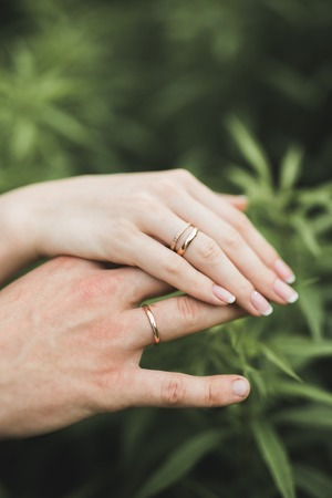boasting: Close up of hands of couple showing the wedding ring .