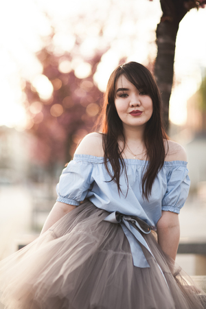 Young Asians girl with modern dress posing in an old Krakow. Stock Photo