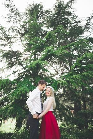 conservatory: Stylish beautiful happy wedding couple kissing and embracing in Botanical Garden.