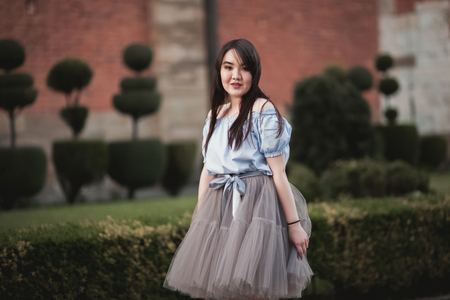 Young Asians girl with modern dress posing in an old Krakow Stock Photo
