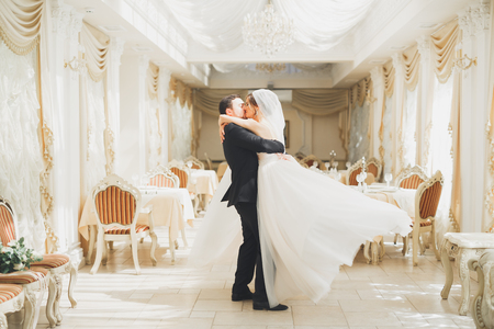 Romantic couple dancing and kissing on their wedding