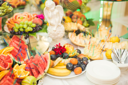 mixed marriage: Authentic buffet, assorted fresh fruits, berries and citrus. Preparation for design creative menu