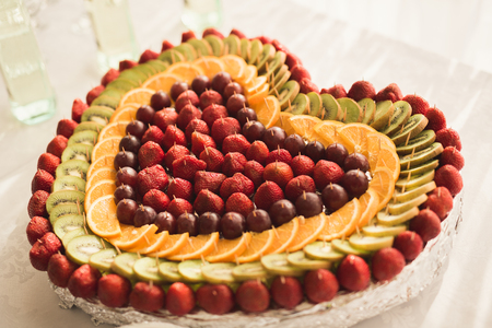 Different fresh fruits on wedding buffet table Stock Photo - 79833153