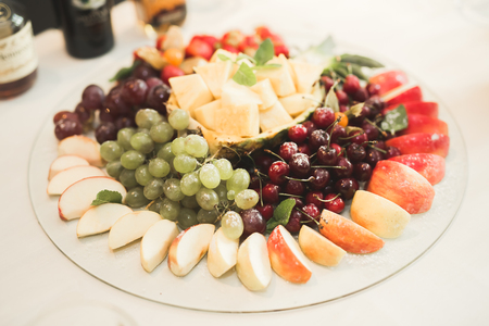 Different fresh fruits on wedding buffet table Stock Photo - 79833170