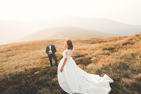 carpathians: Beautifull wedding couple kissing and embracing near mountain with perfect view Stock Photo