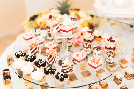 ombre: Delicious sweets on wedding candy buffet with desserts, cupcakes. Stock Photo
