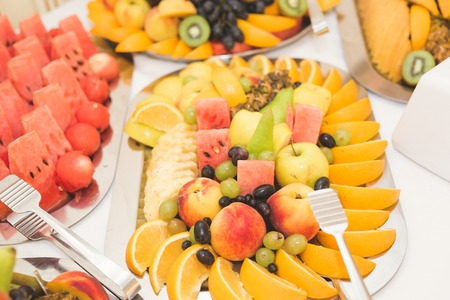 Different fresh fruits on wedding buffet table.