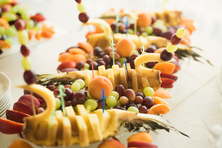 Different fresh fruits on wedding buffet table. Stock Photo - 83370873