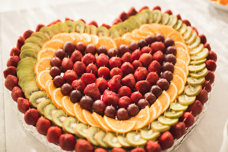 Different fresh fruits on wedding buffet table. Stock Photo - 83595260