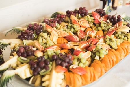 Different fresh fruits on wedding buffet table. Stock Photo - 83595286
