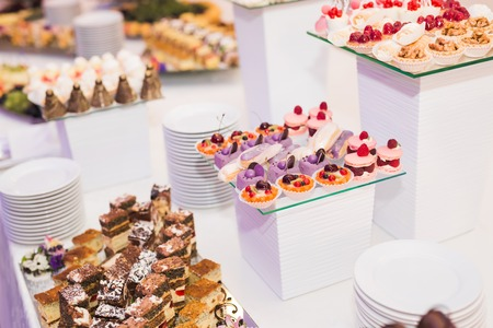 Different kinds of baked sweets on a buffet.