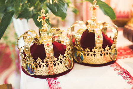 Golden crowns lying on the table in church Banco de Imagens