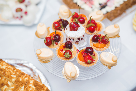 Delicious wedding reception candy bar dessert table. Stock fotó