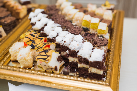 Delicious sweets on wedding candy buffet with desserts, cupcakes