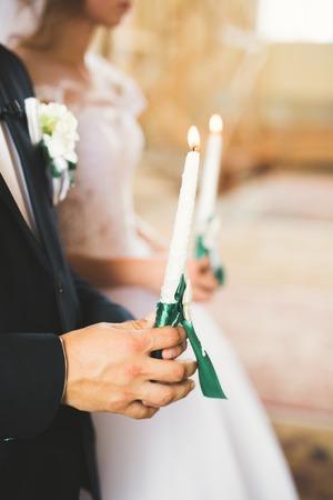 結婚式のカップルを待つ、新郎は、教会で結婚 写真素材