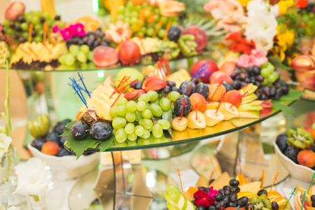Different fresh fruits on wedding buffet table Stock Photo - 88359527