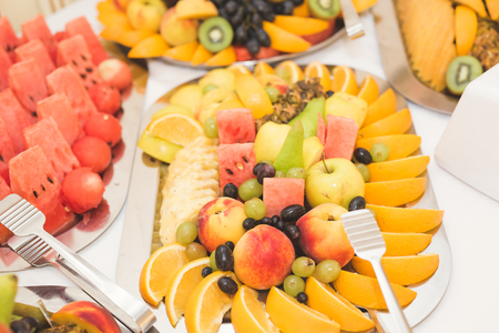 Different fresh fruits on wedding buffet table Stock Photo - 88359536