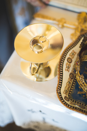 Wedding rings on ceremony at church. Macro