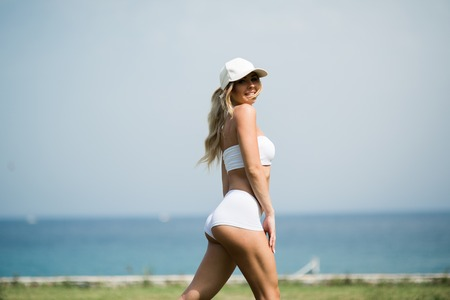 Fitness Body of Beautiful Blonde Woman on the Beach Imagens
