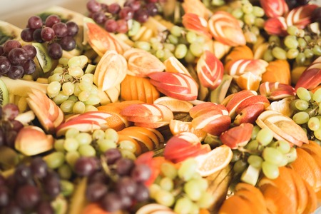 Different fresh fruits on wedding buffet table Stock Photo - 90338872