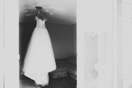 The perfect wedding dress in the room of the bride.