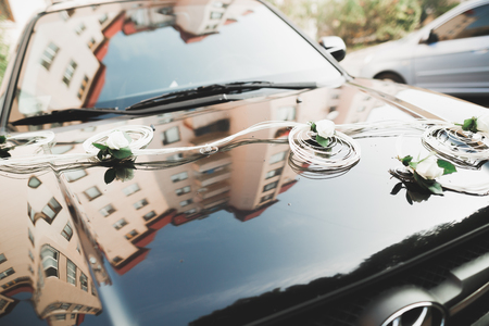 Wedding car decorated with beautiful, luxury flowers