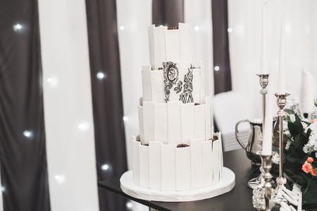 Luxury decorated wedding cake on the table Archivio Fotografico