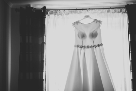 The perfect wedding dress in the room of the bride Reklamní fotografie - 98836874