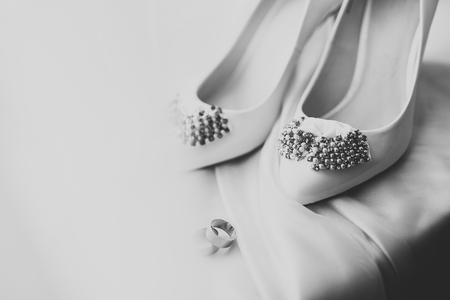 White stylish wedding shoes for bride. Close-up