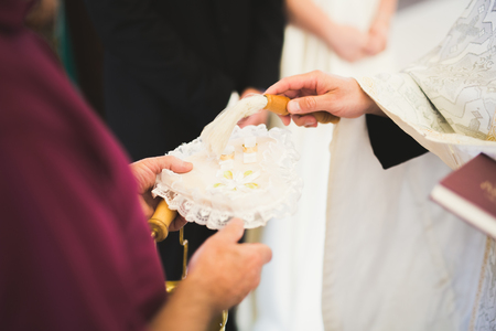 Wedding rings on ceremony at church. Macro.
