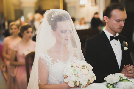 Wedding couple bide and groom get married in a church Stok Fotoğraf - 99360138