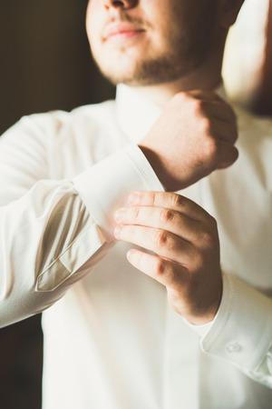 Luxury groom prepares for wedding in hotel