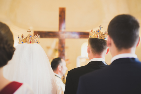 Wedding couple bide and groom get married in a church