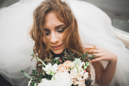 Portrait of a beautiful happy bride with bouquet