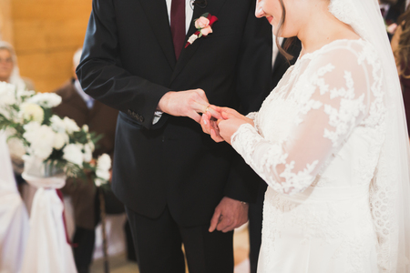 Bride and groom exchanging wedding rings. Stylish couple official ceremony Stock Photo